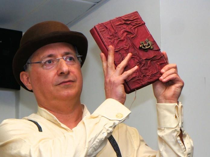 Rod Duncan displaying The Bullet Catcher's Handbook